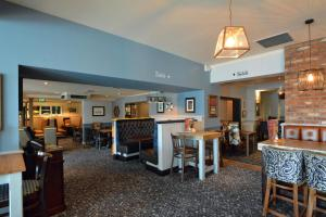 A restaurant or other place to eat at Farmhouse Innlodge by Greene King Inns