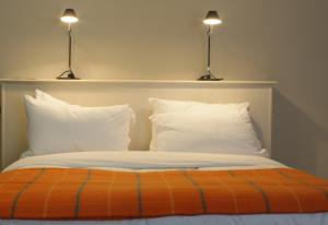 A bed or beds in a room at The Angel Hotel