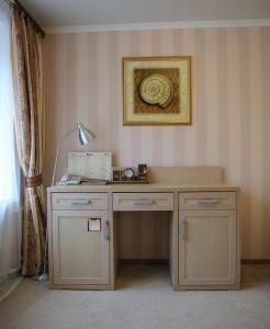 Кухня или мини-кухня в СеверСити гостиница