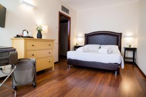 Letto o letti in una camera di Astoria Palace Hotel