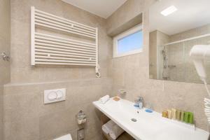 A bathroom at Medora Auri Family Beach Resort
