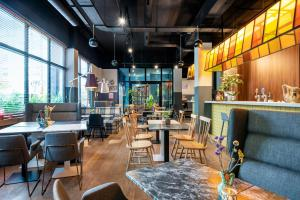 A restaurant or other place to eat at Hotel Kaijoo by HappyCulture