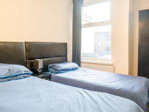 A bed or beds in a room at La Tavola Calda Hotel