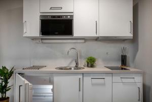 A kitchen or kitchenette at Hotel Arkaden