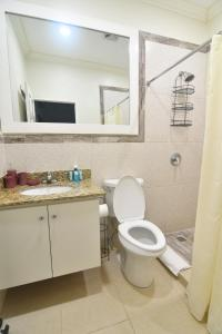 A bathroom at Choose To Be Happy at Gardens of Blissett - One and Two Bedroom Apartments