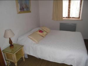 A bed or beds in a room at Domaine du Breuil