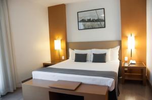 Cama ou camas em um quarto em H2 Platinum Lourdes