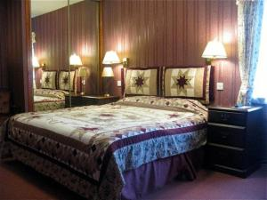 A bed or beds in a room at Gairloch Highland Lodge