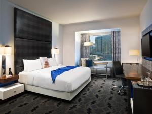 A bed or beds in a room at W Dallas - Victory
