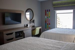 A bed or beds in a room at Hampton Inn & Suites Portland West
