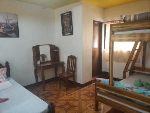 A seating area at Elnido Blessed Homestay