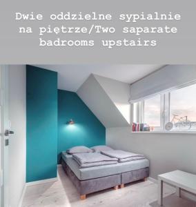 A bed or beds in a room at Czerwone Żagle Apartamenty Całoroczne