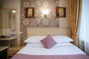Кровать или кровати в номере СеверСити гостиница