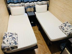 A bed or beds in a room at Sleep In Hotel