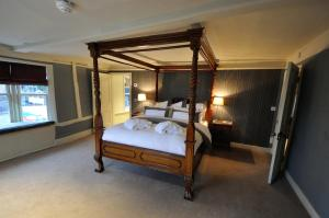 A bed or beds in a room at The Marlborough