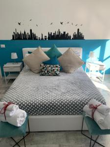 A bed or beds in a room at Blue Home