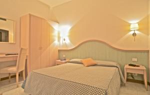 Letto o letti in una camera di Hotel Splendid