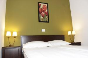 A bed or beds in a room at La Livada