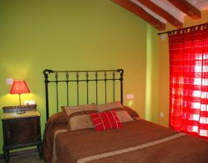 Cama o camas de una habitación en Albergue Ull de Canals