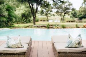 The swimming pool at or near Tanda Tula Safari Camp