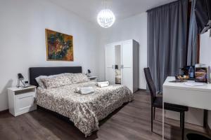 A bed or beds in a room at B&B Amalfi's Luxury Rooms