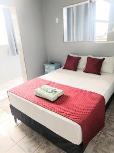 Cama ou camas em um quarto em Pousada Balbino