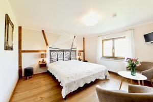 Ein Bett oder Betten in einem Zimmer der Unterkunft Hotel Montfort-Schlössle
