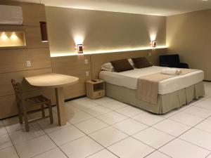 A bed or beds in a room at Hotel Meridional