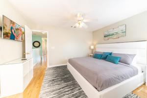 A bed or beds in a room at Lovely Disney Vacation House