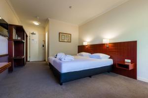 A bed or beds in a room at Postillion Hotel Arnhem