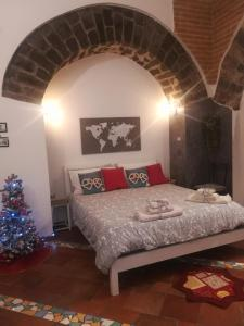 """A bed or beds in a room at """"Il Turista"""" Holiday Home"""