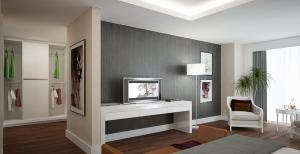 A television and/or entertainment centre at Triumph City Hotel & Residences