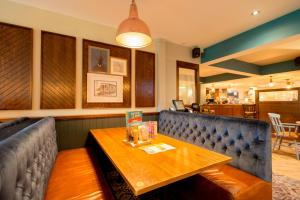 The lounge or bar area at The Broughton Hotel by Greene King Inns