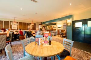 A restaurant or other place to eat at The Broughton Hotel by Greene King Inns