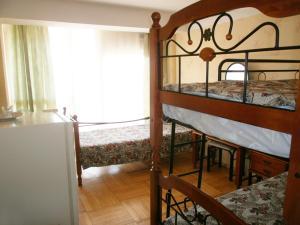 Кровать или кровати в номере Парк Отель Марат