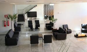 Uma área de estar em Pontal Plaza Hotel