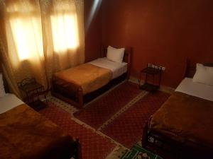 A bed or beds in a room at Hotel Marmar