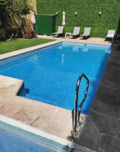 The swimming pool at or near Hotel Crillon Mendoza