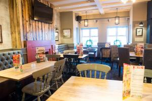 A restaurant or other place to eat at Old Grey Mare Inn by Greene King Inns