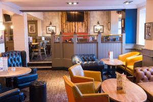 The lounge or bar area at Old Grey Mare Inn by Greene King Inns