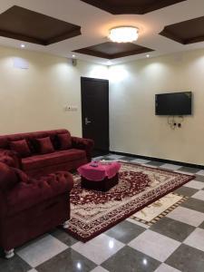Uma área de estar em Zahret Al-Badea Hotel Apartments
