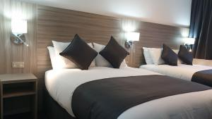 A bed or beds in a room at The Bruce Hotel