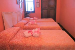 A bed or beds in a room at Agriturismo Santa Margherita