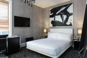 A bed or beds in a room at The Square Hotel