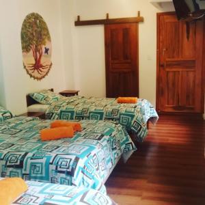 Cama o camas de una habitación en Hostal & Spa Casa Real