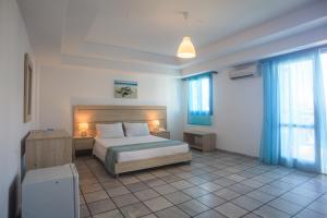 Кровать или кровати в номере Marilisa Hotel