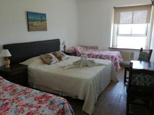Una cama o camas en una habitación de Aguas del Monte Hotel SPA