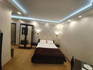Кровать или кровати в номере Отель Восток
