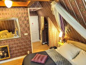 A bed or beds in a room at Rezidence Zámeček - Boutique Hotel