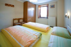 Postel nebo postele na pokoji v ubytování Castellani Livigno Apartments